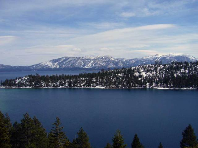 East shore (lateral glacial morraine) of Emerald Bay from Vikingsholm Trail.  Heavenly Ski Resort and the southeast shore of Lake Tahoe can be seen in the distance.