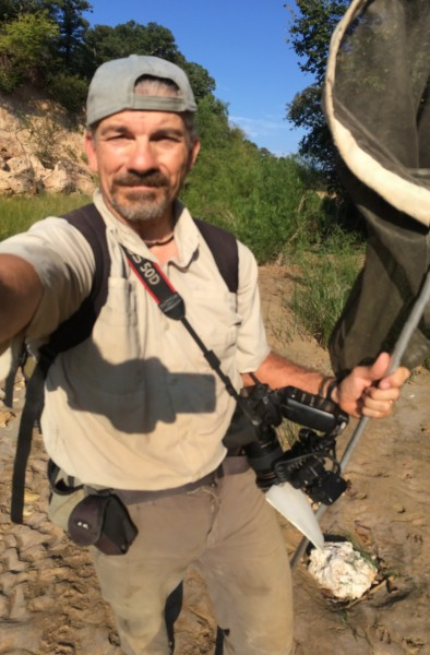 Ted MacRae w/ field collecting equipment & camera